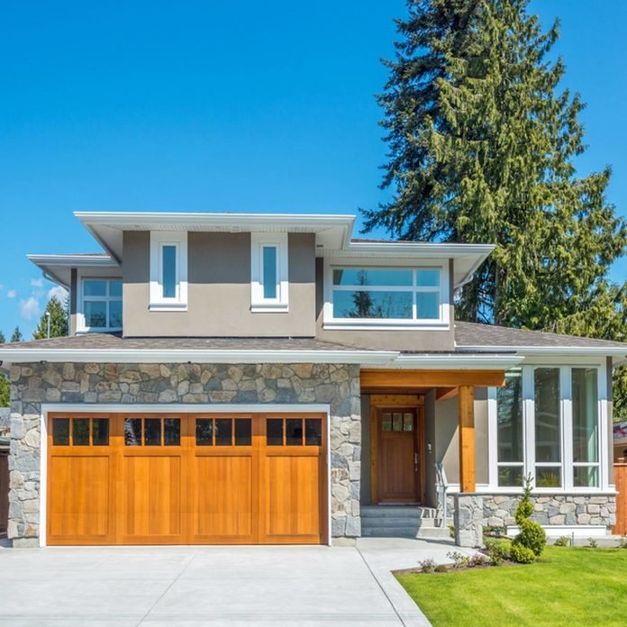 17oct94-2018_271404422_04-house-color-1200x1200 home exterior with wooden garage doors