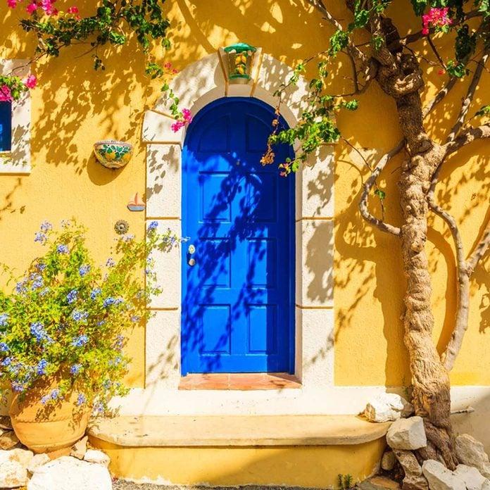 blue door yellow stucco siding Mediterranean home exterior home colors, house exterior colors