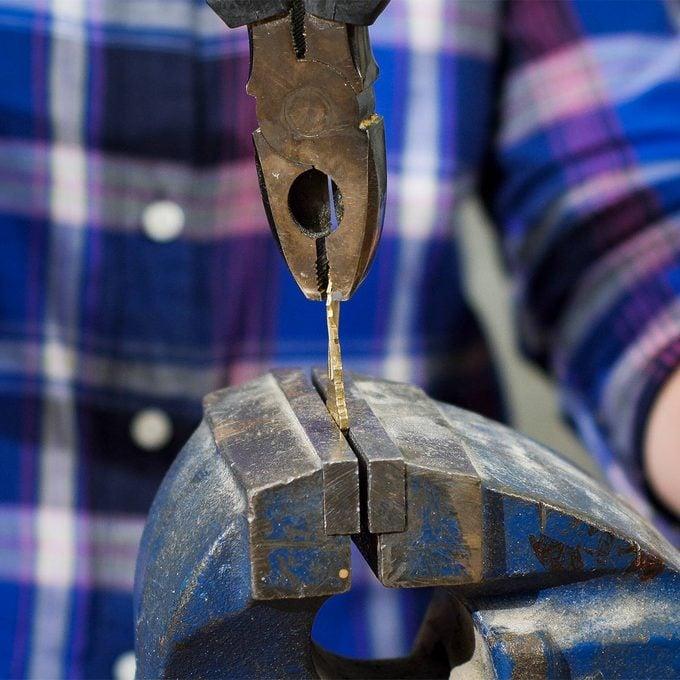 use pliers to fix a twisted key