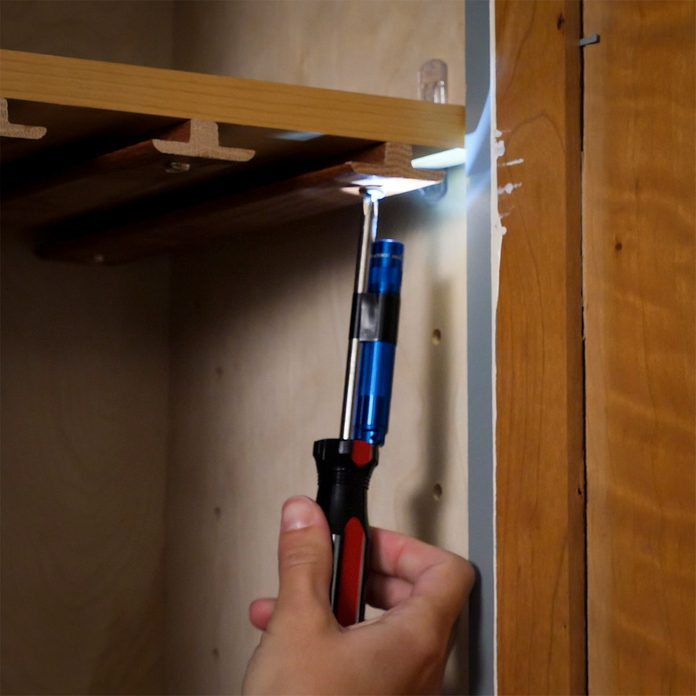 lighted screwdriver in cabinet