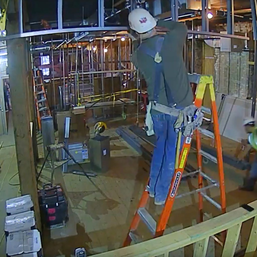 Workers positioning a Time Lapse camera | Construction Pro Tips