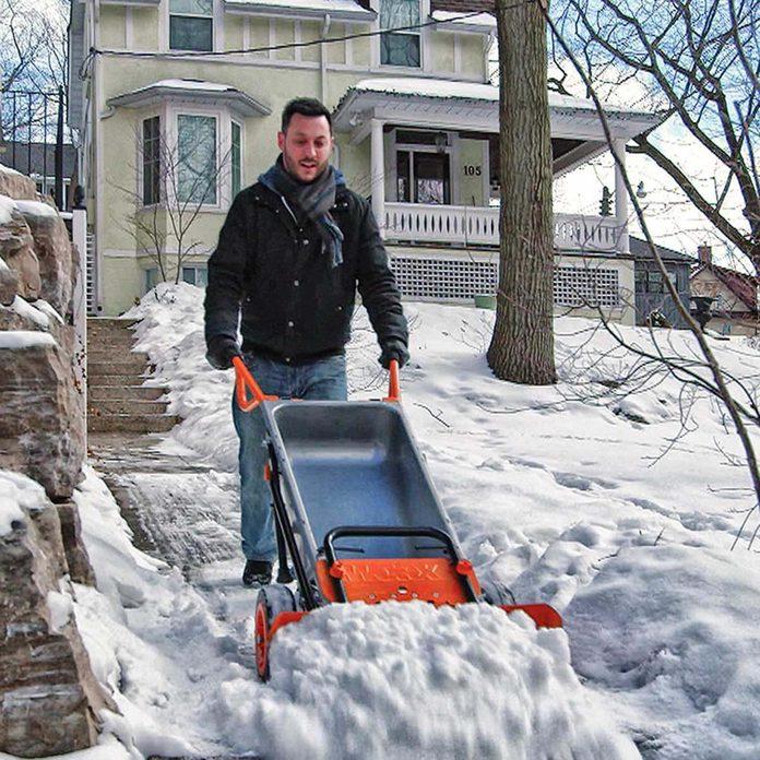 Wheelbarrow snow plow