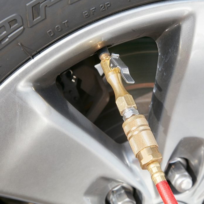 A lock on air chuck hooked into a tire   Construction Pro Tips