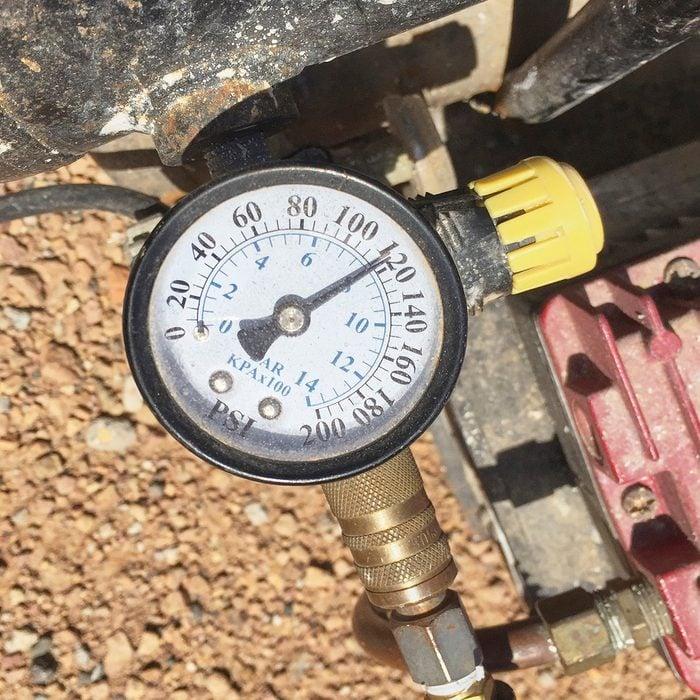 Adjustable pressure gauge on a compressor   Construction Pro Tips