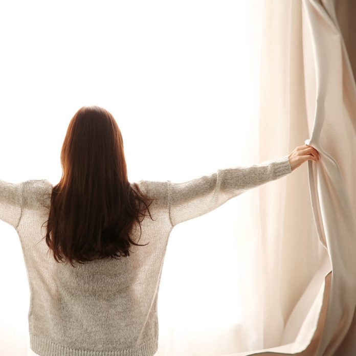 dfh4_shutterstock_544153177 open up blinds curtains to let sun in