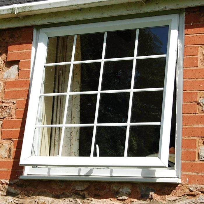 open window on a brick house