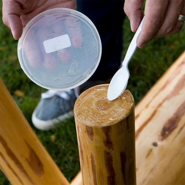 spread epoxy onto bench feet