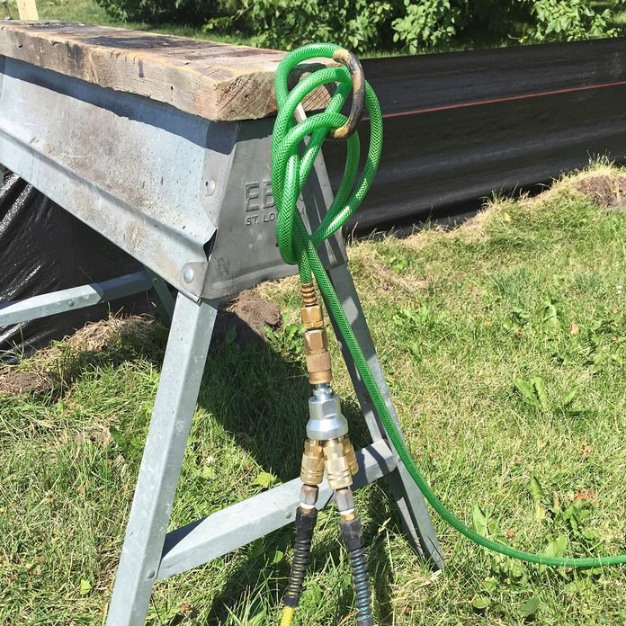 Air hoses hooked around a saw horse   Construction Pro Tips