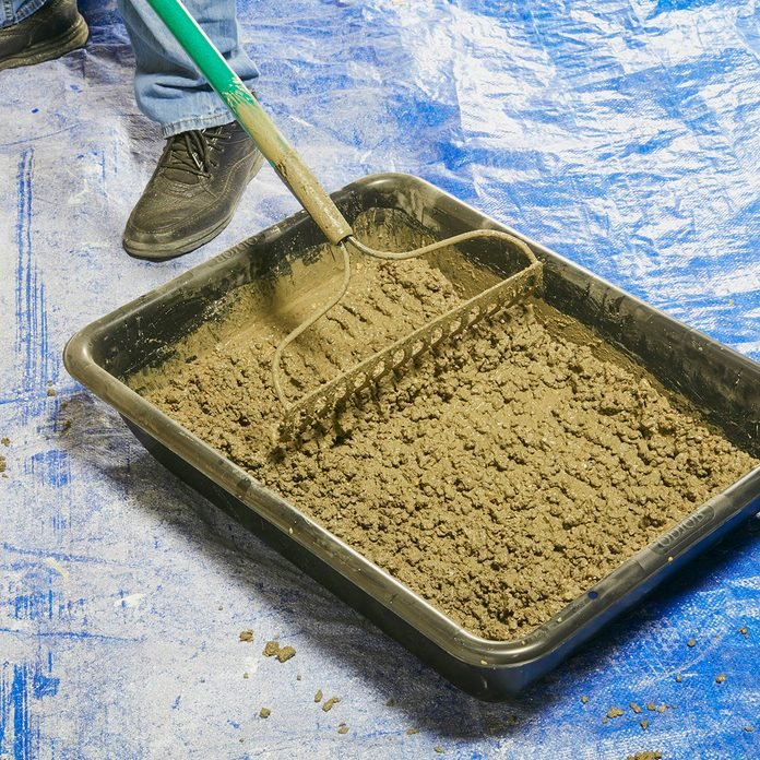 Mixing concrete in a tub with a rake | Construction Pro Tips