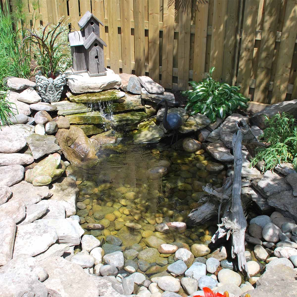 Pretty and small backyard fish pond ideas at decor for Small coy pond