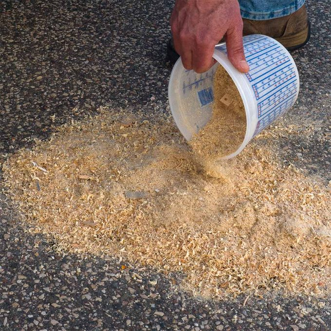 spread sawdust over oil spill