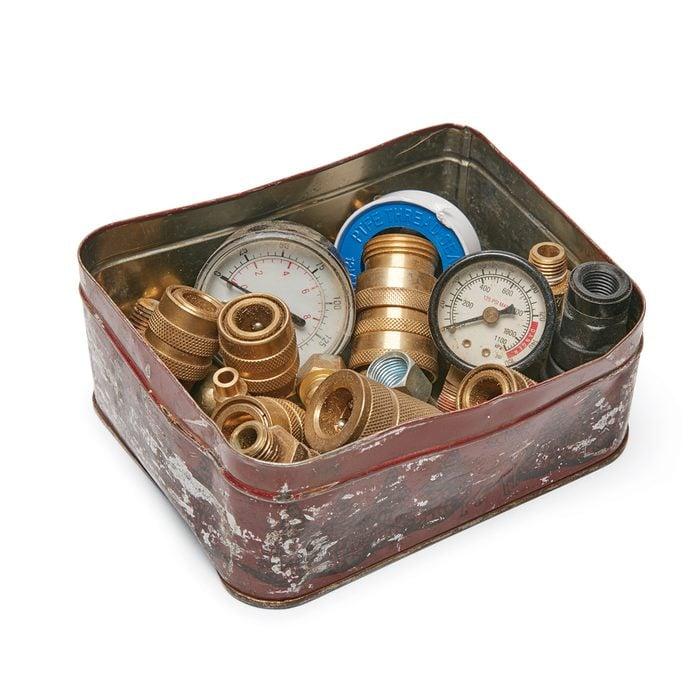 a tin bin full of air compressor parts   Construction Pro Tips