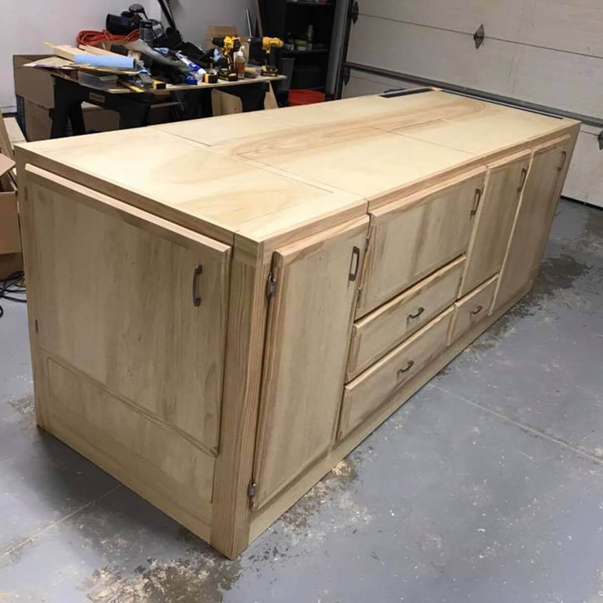 workbench with tools flipped into storage cabinets