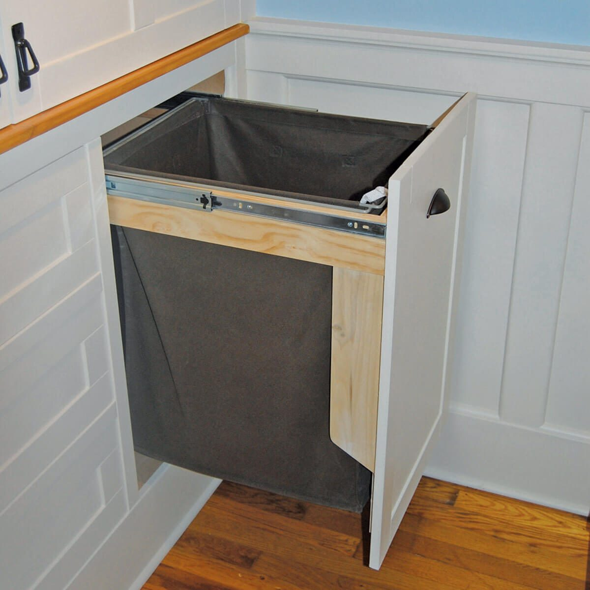 laundry room ideas Slide out laundry hamper