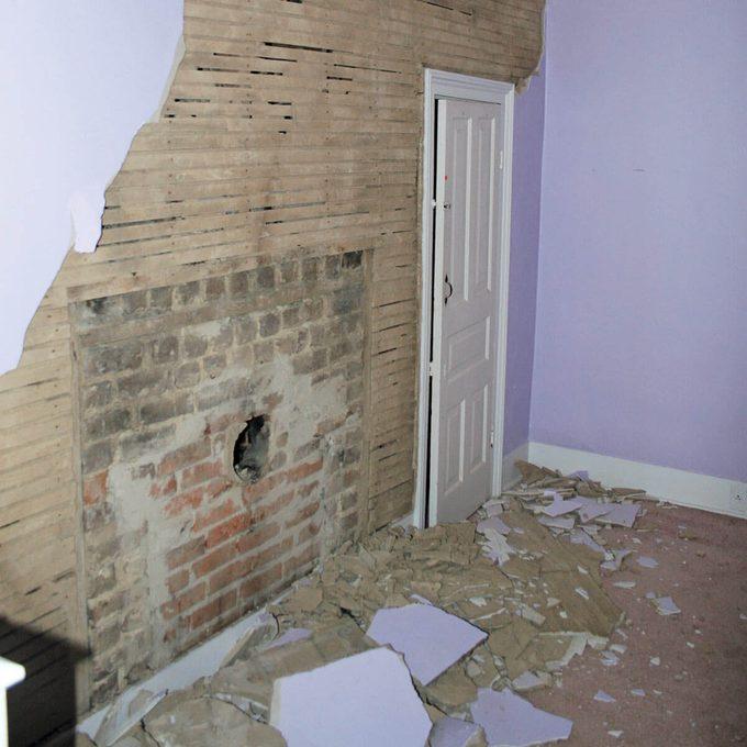 hidden fireplace behind plaster wall