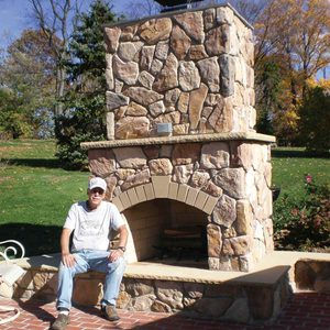 backyard stone fireplace