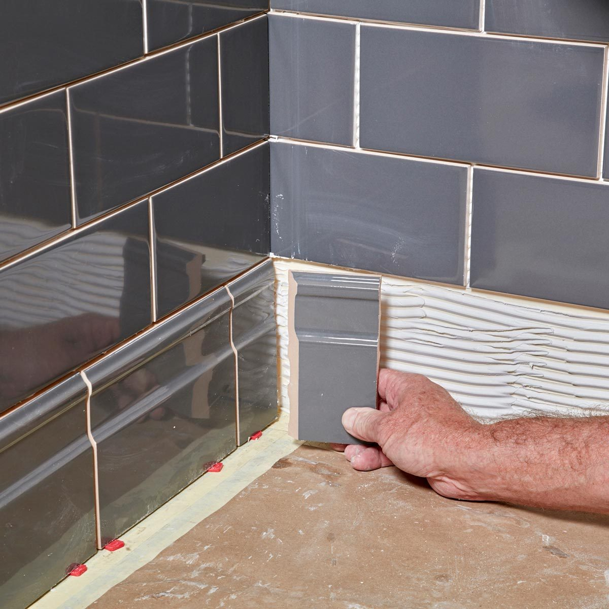 Tiling Inside Corners Miter the base at the inside corners