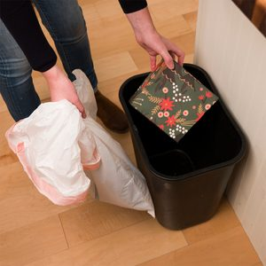 hiding a gift inside a trash can