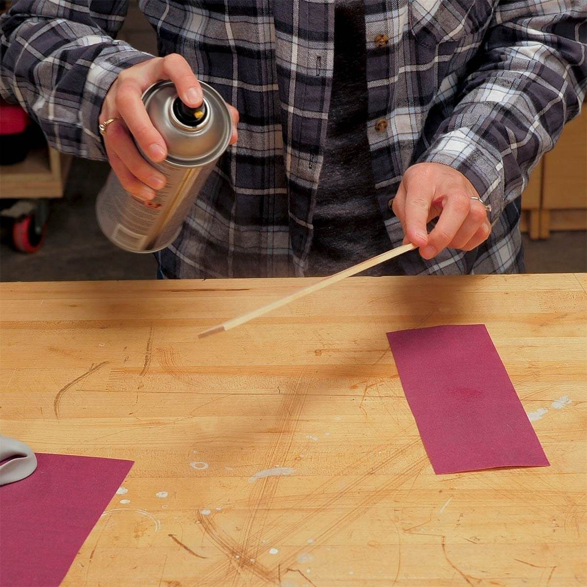 gluing sandpaper to paint stick