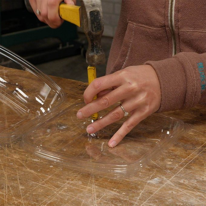 punching holes in plastic clamshell container from salad bar