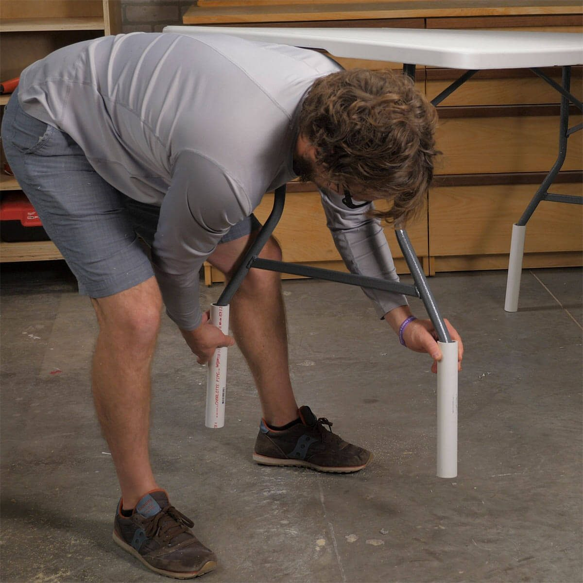 adding pvc to table legs to make a taller table