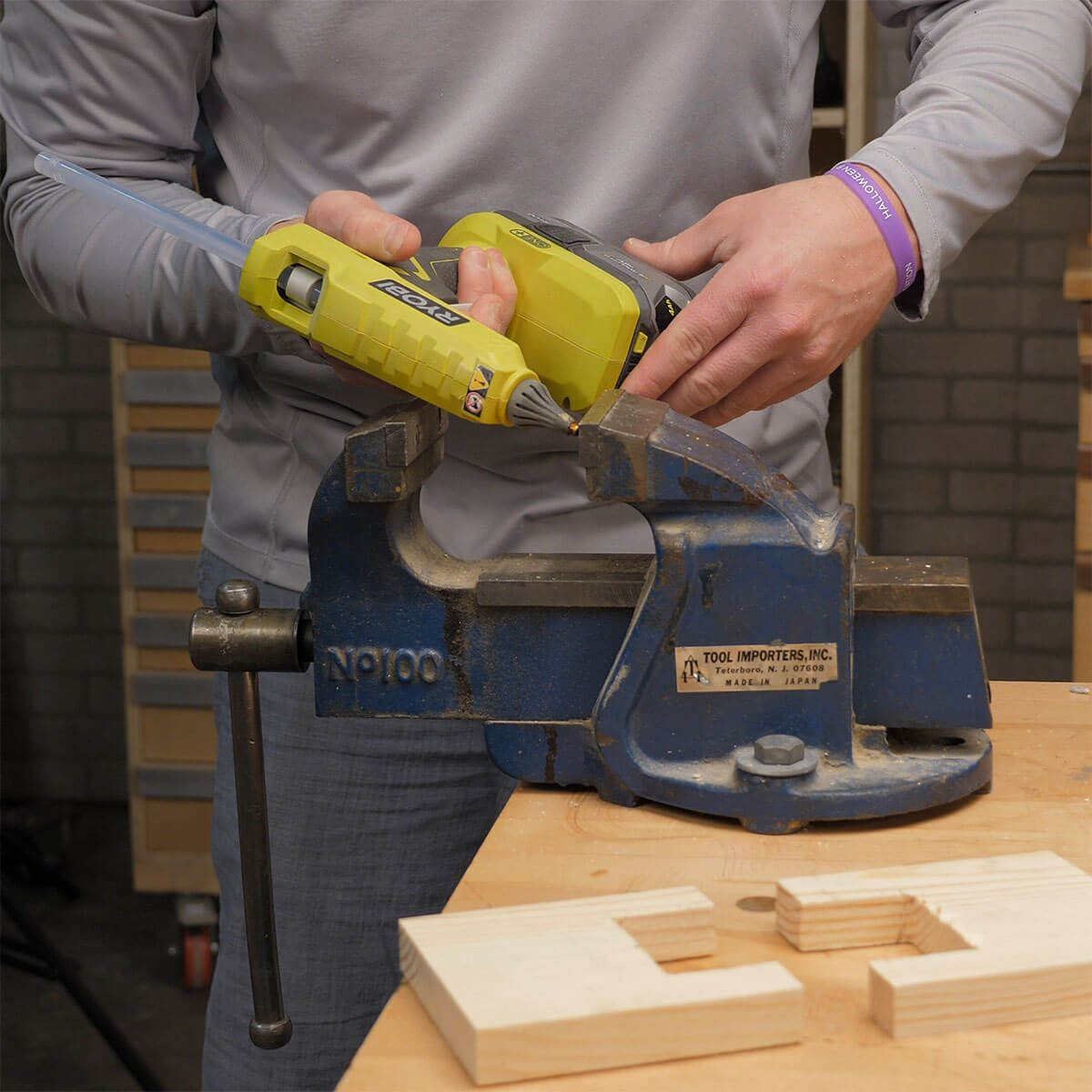 adding hot glue to hold pads on mechanics vise