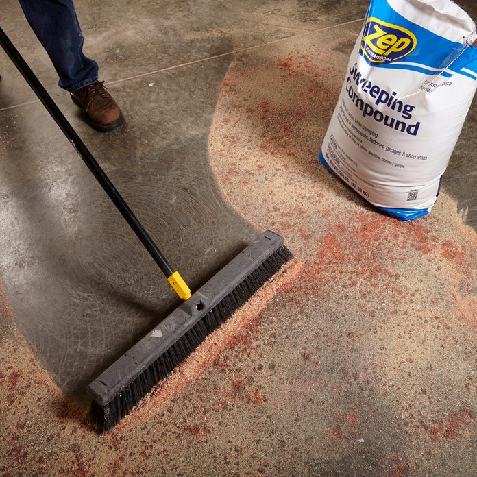Sweeping up sweeping compound | Construction Pro Tips