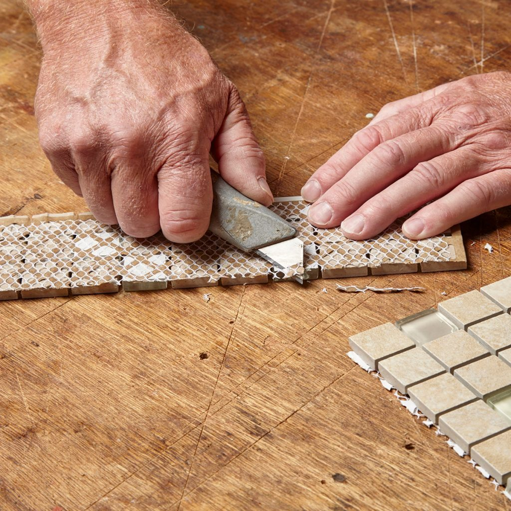 cutting off the extra strands of tile backer   Construction Pro Tip