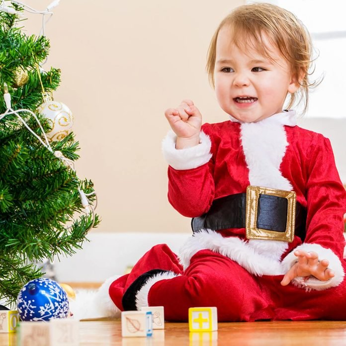 cooltotouch_322515644_02 christmas lights baby in santa outfit christmas