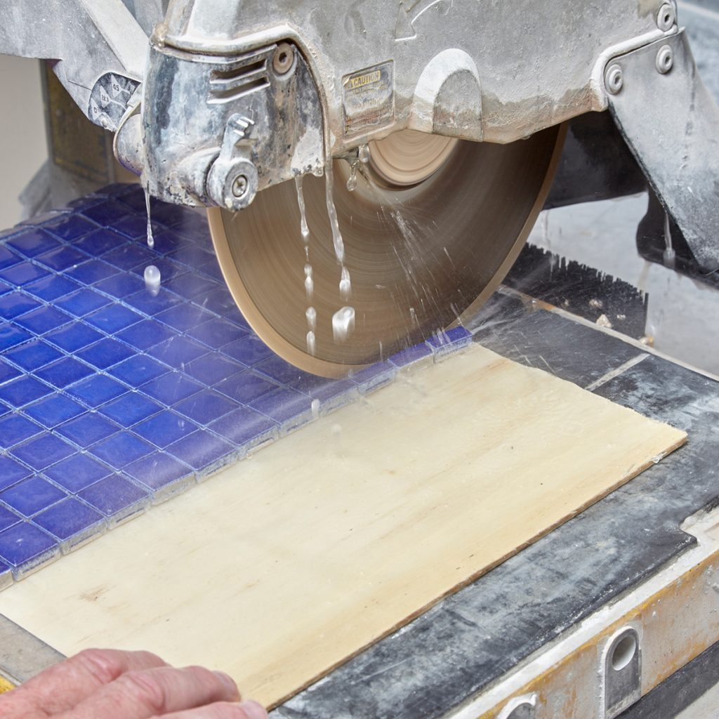 cutting tile on a cutter | Construction Pro Tip