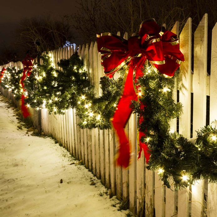 durable_131642774_04 christmas lights on white picket fence