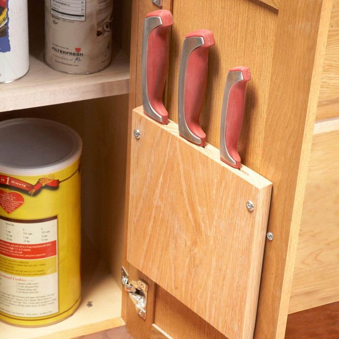 hidden knife storage on the inside of a cabinet fh11jau_520_33_016