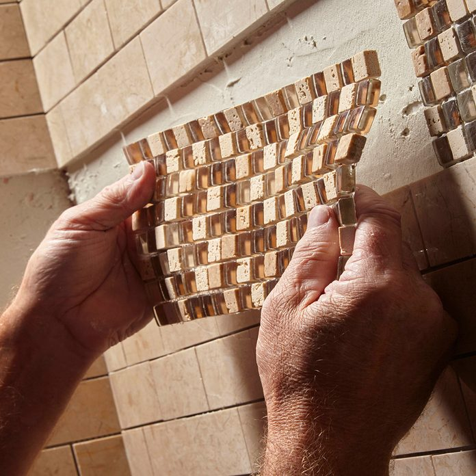 positioning a piece of mosaic tile | Construction Pro Tip