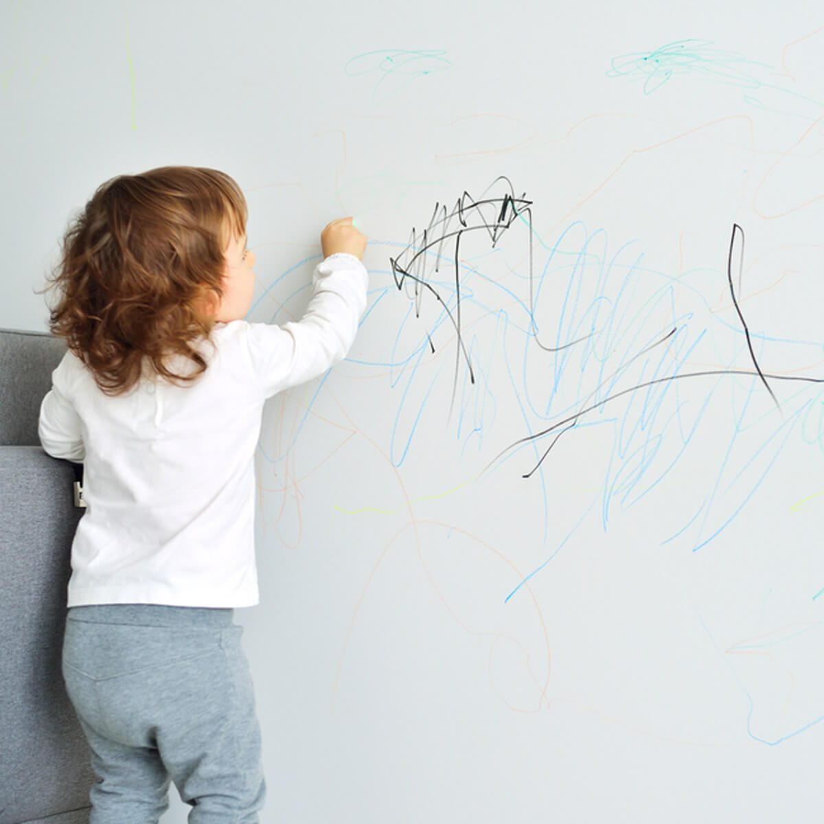 Kid drawing wall crayon marker