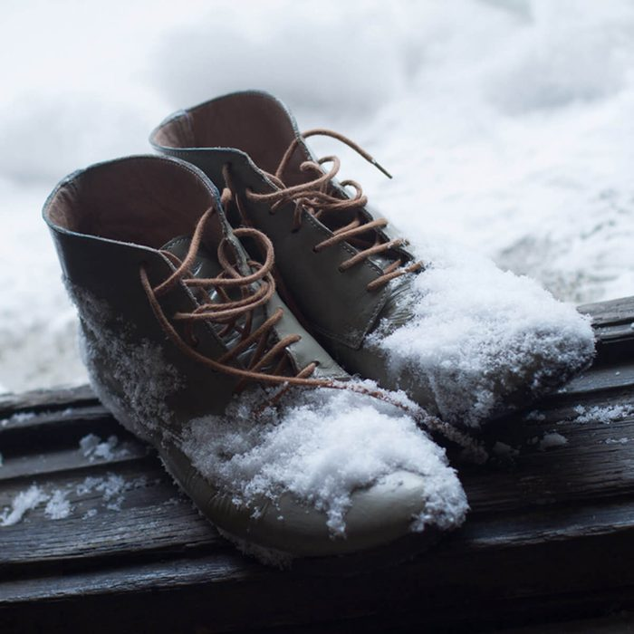 snow boots in the entryway of home