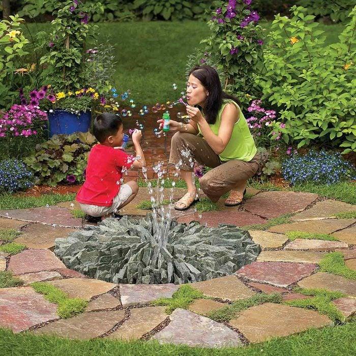 stone fountain backyard