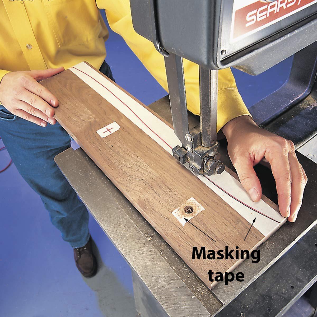sawing on dark wood