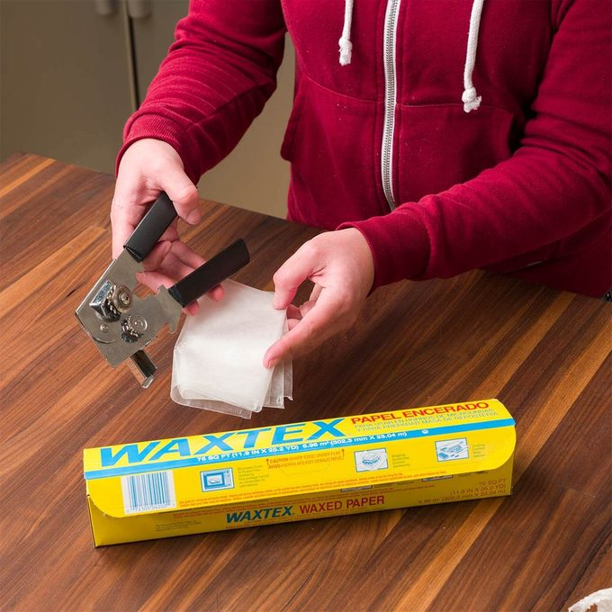 clean can opener with wax paper