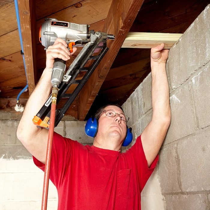 Install blocking between joists   Construction Pro Tips