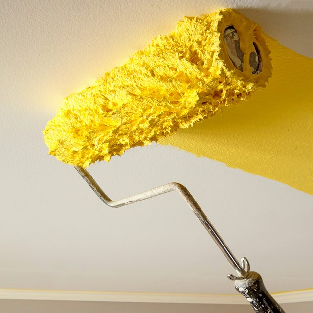 Rolling yellow paint onto a ceiling | Construction Pro Tips
