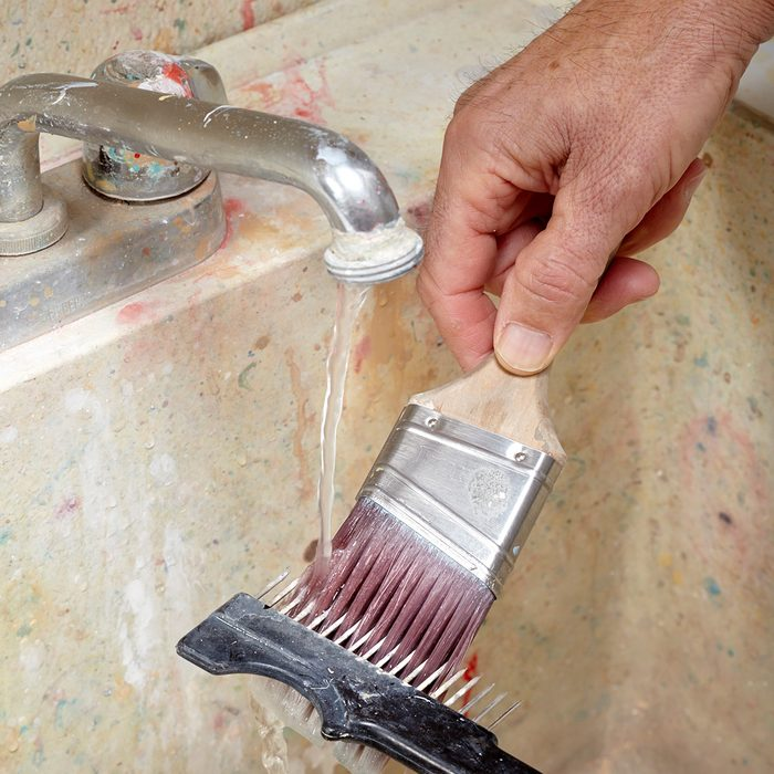 Combing through a paint brush   Construction Pro Tips