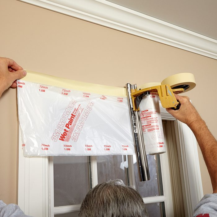 Completely cover your windows with roll on plastic   Construction Pro Tips