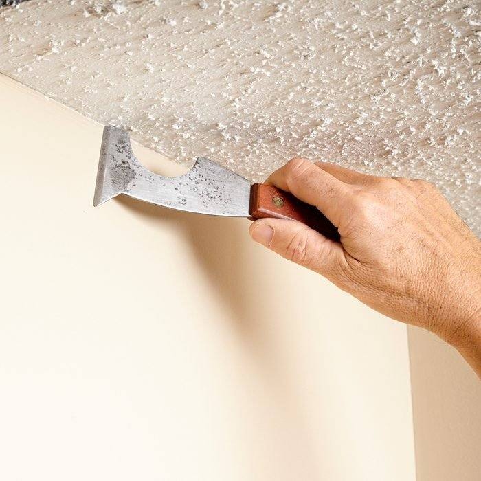 Clearing out popcorn along the ceiling line   Construction Pro Tips