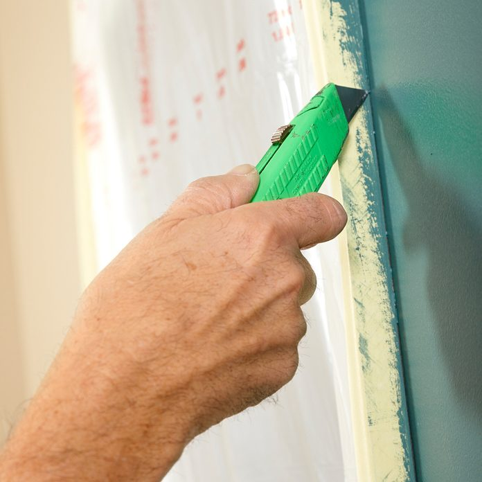 Cut the tape before pulling from the wall to prevent tearing | Construction Pro Tips