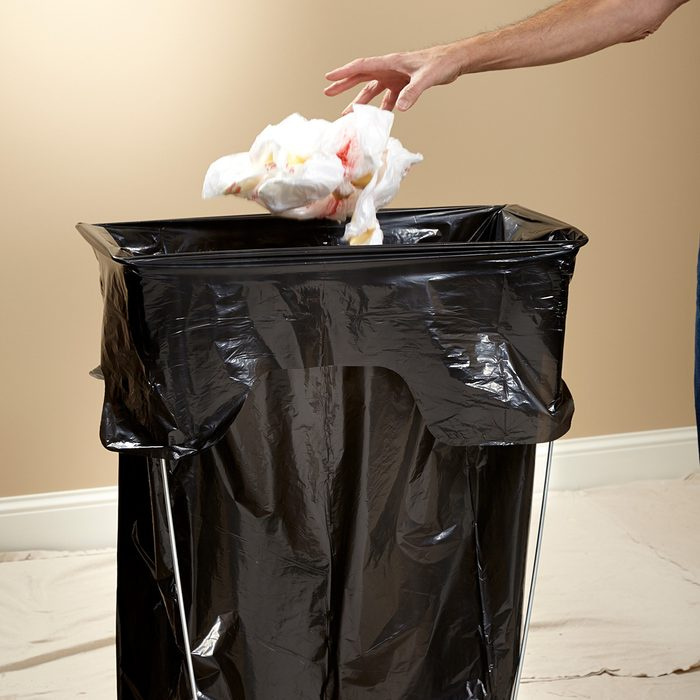 Keep a garbage can close for easy trash removal   Construction Pro Tips