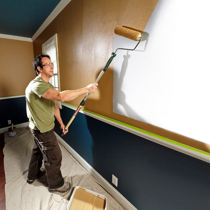 Professional painter rolling paint on to a wall   Construction Pro Tips