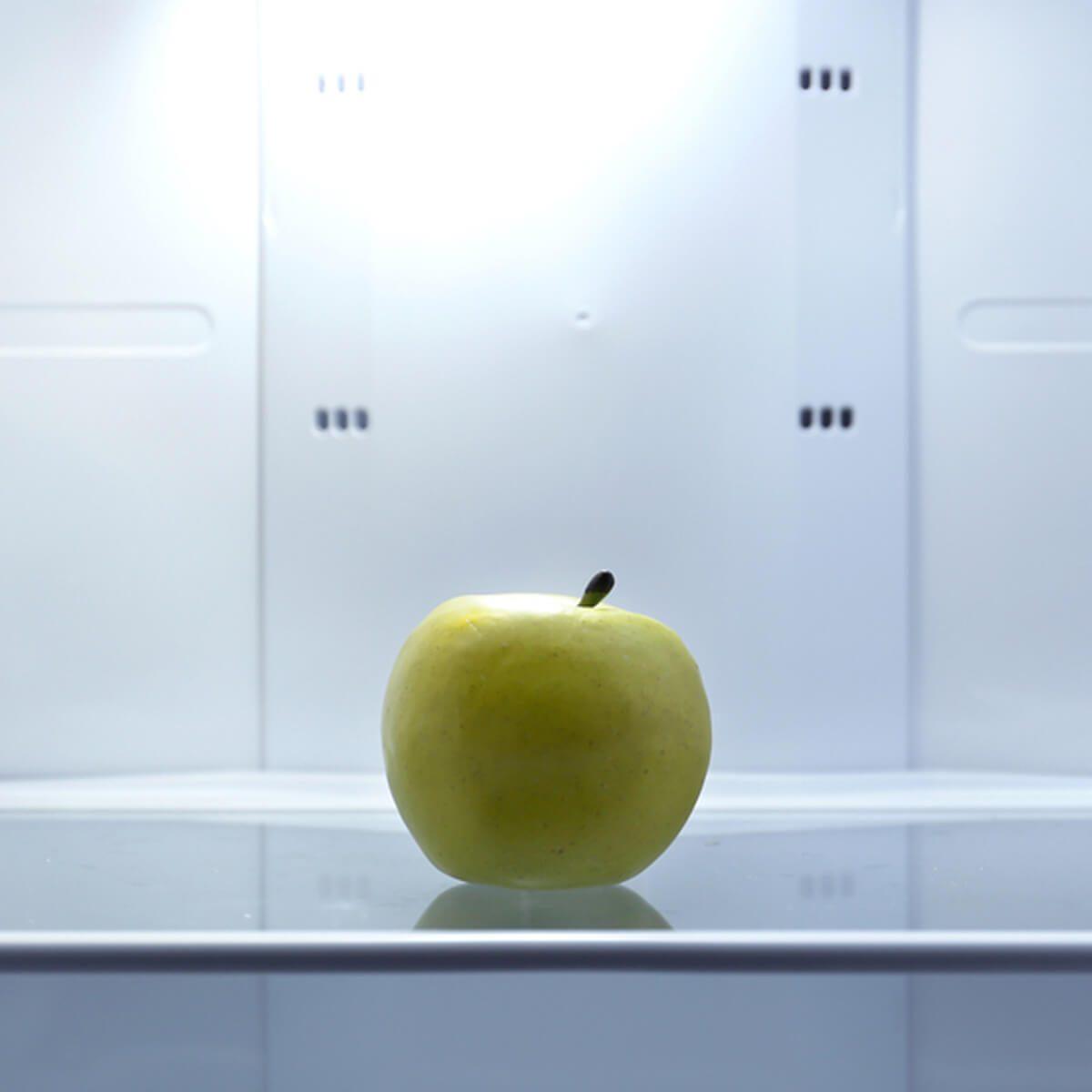 shutterstock_166658534 apple in empty clean fridge