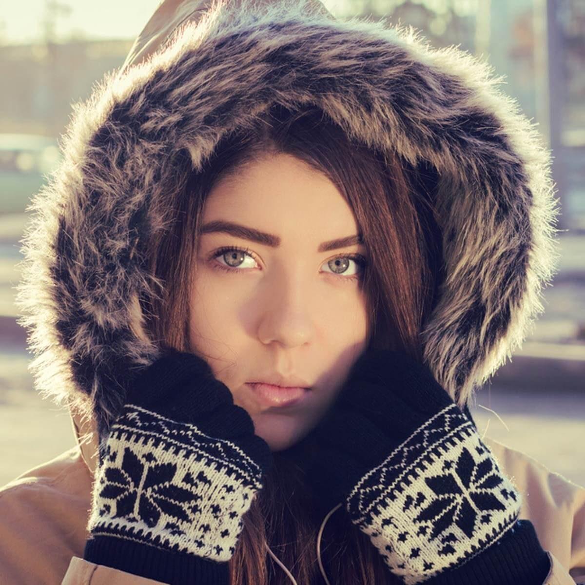 shutterstock_346216421 women in winter coat furry hood