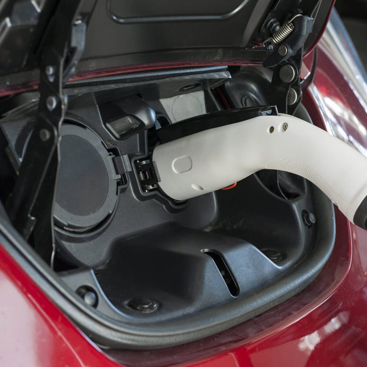 shutterstock_395339038 charging hybrid electric car