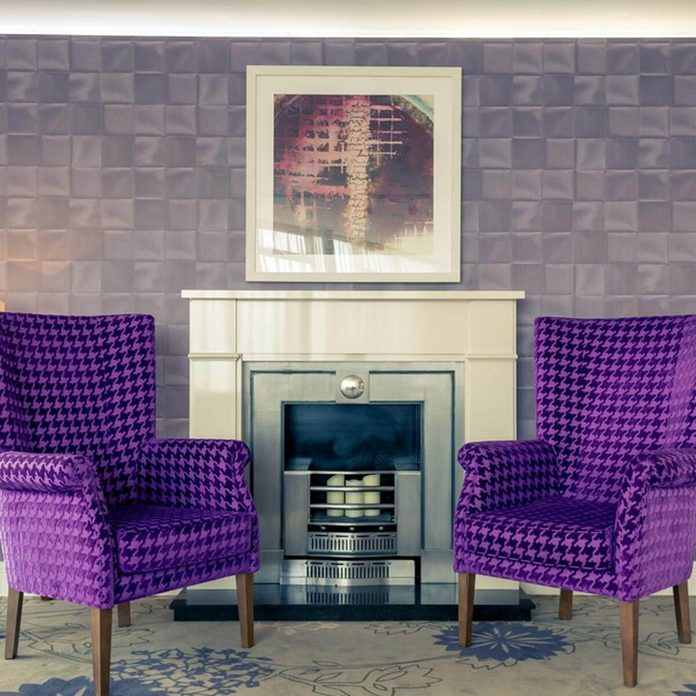 shutterstock_405317956 purple chairs formal living room